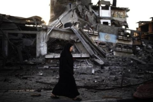 Palestinian woman walks