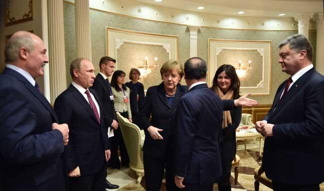 Russian president Viladimir Putin meets Ukranian president Petro Poroshenko in Minsk with Angela Merkel