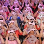 Participants get ready to apply facial masks on their faces in Taipei on July 28, 2013. Some 1,213 people reportedly broke the Guinness World Record by applying facial masks for 10 minutes at the same time in an event organized by a local face mask company. AFP PHOTO / Mandy CHENG