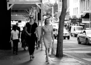 women with desginer handbags