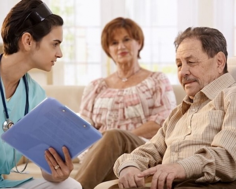 Nurse talking with elderly people