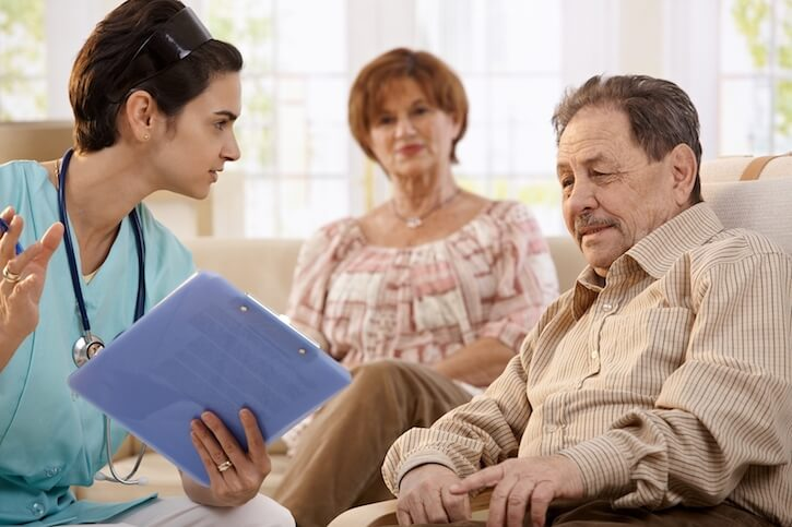 Nurse talking with elderly people