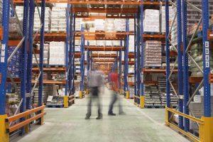 men-walking-in-the-warehouse
