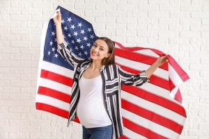 pregnant woman holding american flag